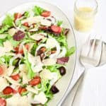 Copycat Giordano's house salad on a serving platter