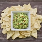 the best classic guacamole in a bowl surrounded by tortilla chips